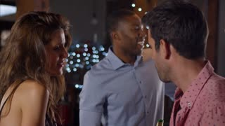 Young adult friends dancing at a party, side view, shot on R3D