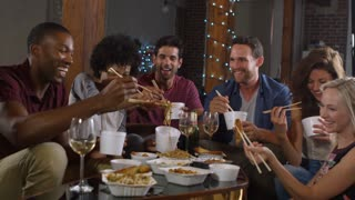 Young adults sharing a Chinese take-away at a party at home, shot on R3D
