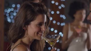 Young man and woman talk and drink at a party, side view, close up, shot on R3D