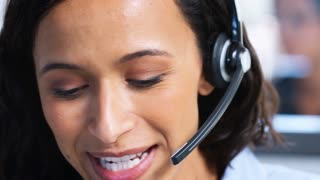 Young mixed race woman working in a call centre, close up