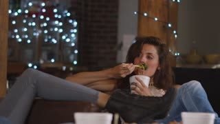 Young woman enjoying girl�s night in with Chinese take-away, shot on R3D