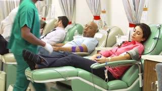 Volunteers Making Blood Donation In Hospital