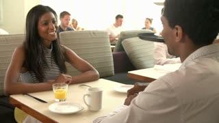 Waitress Serving Couple Breakfast In Hotel Restaurant