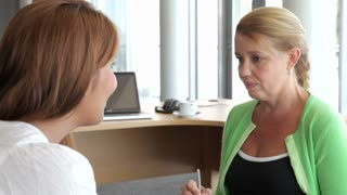 Woman Talking To Female Counsellor In Office
