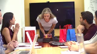 Workers Celebrating Colleague's Birthday In Office