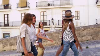 Young adult friends walking in Ibiza, Spain, tracking shot, shot on R3D