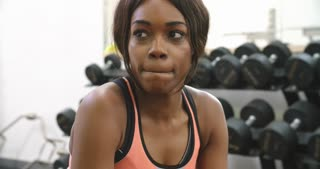 Young African American woman drinking protein shake at a gym