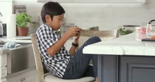 Young Asian Boy Playing Game On Mobile Device Shot On R3D