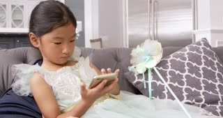 Young Asian Girl Playing Game On Mobile Device Shot On R3D