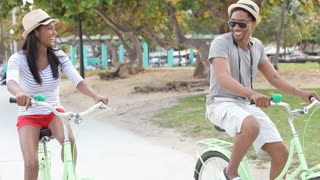 Young Couple Having Fun On Bicycle Ride