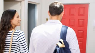 Young Couple Leaving Home For Work Together