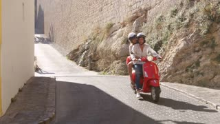 Young couple riding on a scooter, Ibiza, Spain, shot on R3D