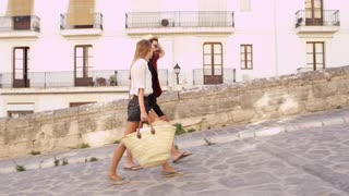 Young couple walking together on vacation in Ibiza, Spain, shot on R3D