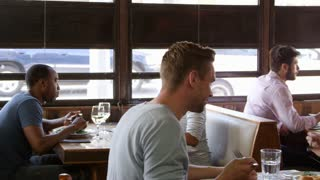 Young couples and friends eating lunch in a restaurant, shot on R3D