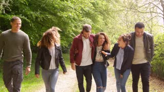 Young couples talk while walking in a country lane, shot on R3D