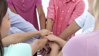 Young People Joining Hands To Celebrate Together