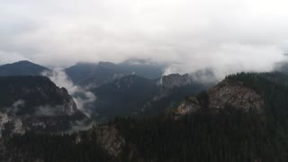 Aerial drone flight over big mountains in Romania, Bicaz 4k 60fps
