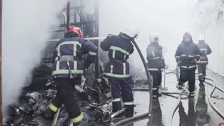Chernivtsi / Ukraine - 03/19/2018: Market with carpets is on fire. Fireman go trough fire