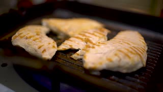 Grilled chicken on grill