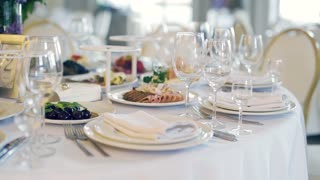 healthy food and white plates and appliances on a white table in a restaurant