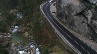 lonely road in mountains. with traffic on the road. 60fps 4k