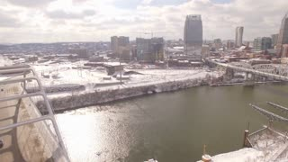 Aerial Snow Nashville Skyline 015 Part 2 Road River Boom Up Pan Right