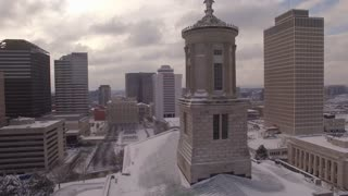 Aerial Snow Tennessee State Capitol 005 Tower And Flags Boom Up