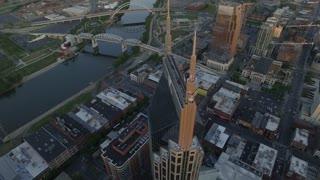 Descending Orbit Around Nashville Skyscraper At Sun Set Looking South