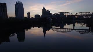 Old Train Bridge With Nashville Skyline Reflection At Dusk