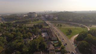 Over Interstate Mixmaster Towards City Skyline At Sunrise