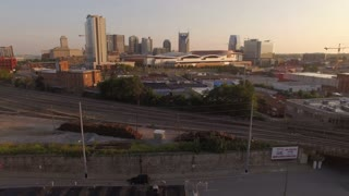 Over Train Tracks Towards Downtown Nashville Skyline At Sunrise