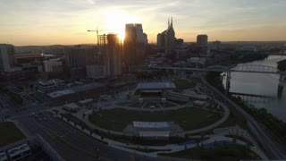 Setting Sun Flares Behind Nashville Skyscraper Skyline