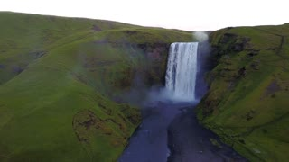 Approaching Gigantic Skogafoss Waterfall In Iceland