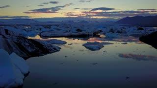 Birds Flying Over Iceland Glacier Lake At Sunset