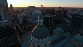 Orbiting Indianapolis State Capitol And Skyline At Sunrise