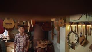 1-Boy In Lute Maker Shop Watching Classic Guitars