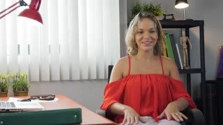 1-Business Woman Playing With Pet Dog In Office