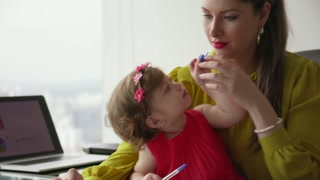 1 Multitasking Business Woman Mother And Daughter In Office