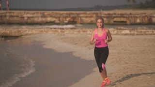1-Slow motion Girl Sports Training Running On Beach