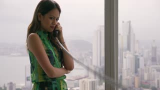 1 Young Latina Businesswoman With Wired Telephone In Modern Office