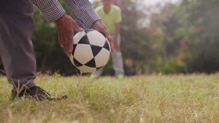 10-Grandpa Playing Soccer Football With Boy