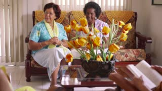10-Senior Women Playing Card Game In Hospice