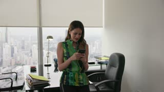 10 Young Latina Businesswoman With Phone In Modern Office
