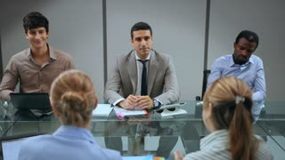 10of20 Team of business people working in office meeting room