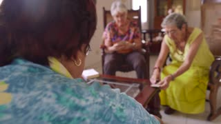 11-Old Women Have Fun Playing Card Game In Hospice