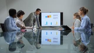 11of20 Team of business people working in office meeting room