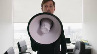 12 White Collar Office Worker Talking With Megaphone At Camera