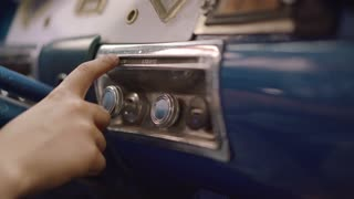 12-Young Boy In Vintage Car Touches Buttons And Controls