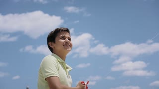 15-Happy Boy Flying Kite On Sunny Day Slowmotion