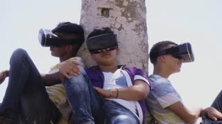 15-Multiethnic Group Of Teenagers Playing Virtual Reality Outdoor
